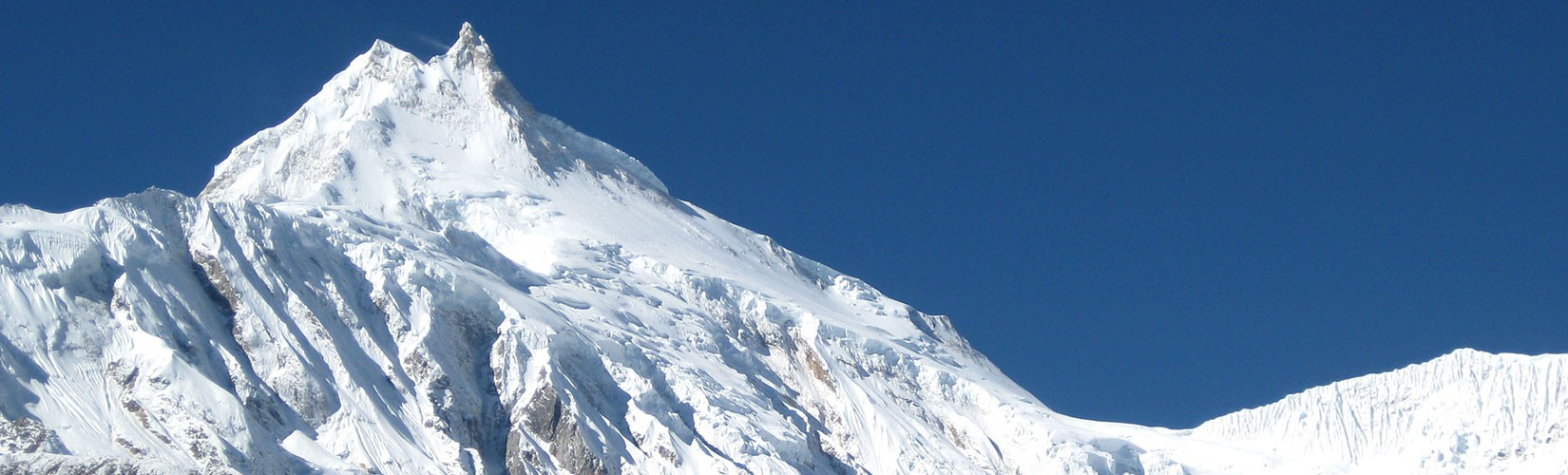 The eighth highest peak of the world, Manaslu, towers 8,163 meters above sea level. It is situated in western central part of Nepal in Mansiri Himal.